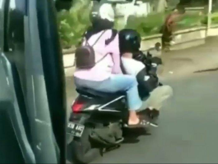 Terapkan Aturan Jaga Jarak, Pemotor Ini Jongkok Ketika Berkendara
